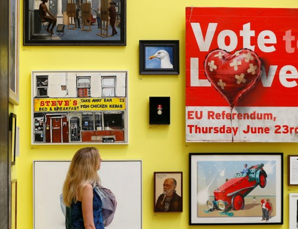An artwork by artist Banksy entitled Vote to Love is seen amongst other works at the Royal Academy of Arts 250th Summer Exhibition, in London, Britain June 5, 2018. REUTERS/Peter Nicholls  NO RESALES. NO ARCHIVES
