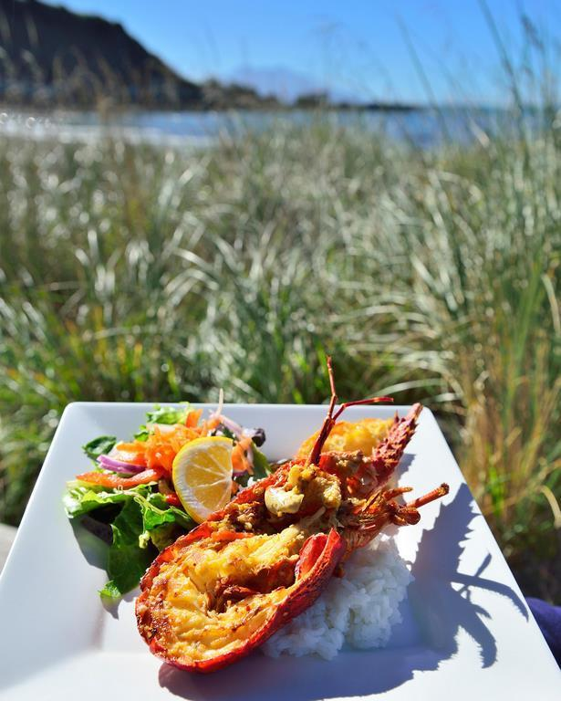 Crayfish meal served  on the road side from Kaikoura Seafood BBQ Kiosk, Kaikoura. South Island New Zealand
